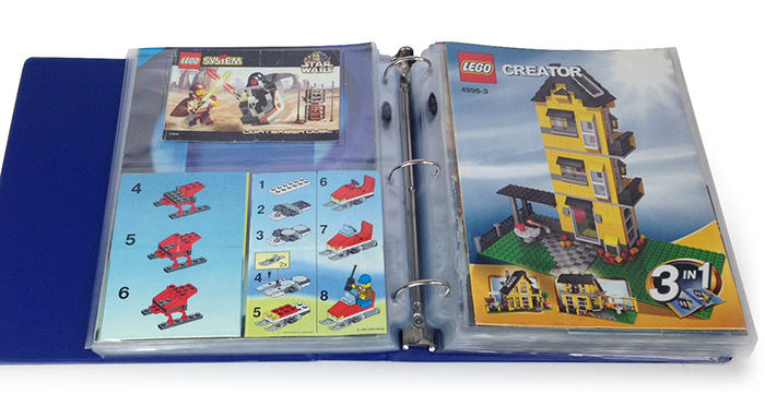 A collection of LEGO books stored for future use.