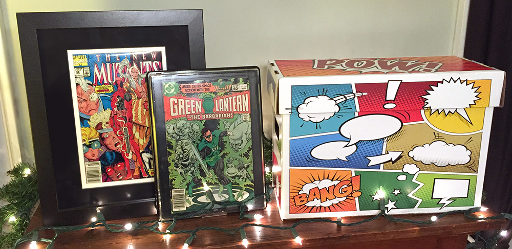 "BCW Comic Book Frame, Comic Book Showcase, and Comic Book ""Pow"" Box"